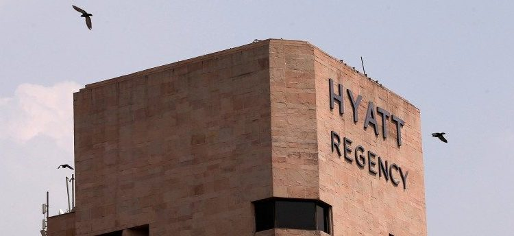 Birds fly past the Hyatt Regency hotel in New Delhi, India, May 30, 2017. REUTERS/Adnan Abidi