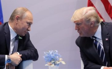 Russian President Putin talks to President Donald Trump during their bilateral meeting at the G20 summit. REUTERS/Carlos Barria