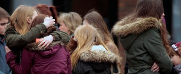 Students hug each other after a memorial service at St. Sixtus church in Haltern am See, March, 27, 2015. Some 16 students and two teachers from Josef-Koenig-Gymnasium high school in Haltern am See, were on board the ill-fated Germanwings flight 4U9525 that crashed in a remote snowy area of the French Alps on Tuesday on its way home to Duesseldorf. REUTERS/Ina Fassbender