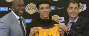 June 23, 2017; Los Angeles, CA, USA; Newly drafted Los Angeles Lakers player Lonzo Ball (center) poses with basketball operations president Magic Johnson and general manager Rob Pelinka during his introductory press conference at Toyota Sports Center. Mandatory Credit: Gary A. Vasquez-USA TODAY Sports - RTS18EVT