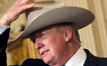"U.S. President Donald Trump wears a cowboy hat as attends a ""Made in America"" products showcase event at the White House in Washington, U.S., July 17, 2017. REUTERS/Carlos Barria TPX IMAGES OF THE DAY - RTX3BUF2"