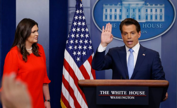 Ex-White House Communications Director Anthony Scaramucci, flanked by White House Press Secretary Sarah Sanders, addresses the daily briefing at the White House in Washington, U.S. July 21, 2017. REUTERS/Jonathan Ernst