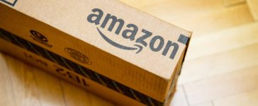 An Amazon package arrives to the customer after delivery. [Shutterstock - Hadrian]