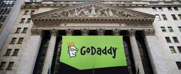 The GoDaddy banner hangs outside of the New York Stock Exchange as the website hosting service makes its initial public offering (IPO) on April 1, 2015. (Photo by Spencer Platt/Getty Images)