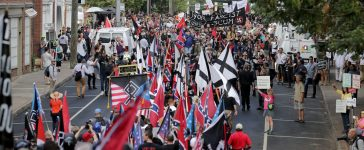 "CHARLOTTESVILLE, VA - AUGUST 12: Hundreds of white nationalists, neo-Nazis and members of the ""alt-right"" march down East Market Street toward Lee Park during the ""Unite the Right"" rally August 12, 2017 in Charlottesville, Virginia. After clashes with anti-fascist protesters and police the rally was declared an unlawful gathering and people were forced out of Lee Park, where a statue of Confederate General Robert E. Lee is slated to be removed. (Photo by Chip Somodevilla/Getty Images)"