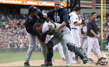 Austin Romine #27 of the New York Yankees is held back by Victor Martinez #41 of the Detroit Tigers during a bench clearing fight in the sixth inning at Comerica Park on August 24, 2017 in Detroit, Michigan. (Photo by Gregory Shamus/Getty Images)