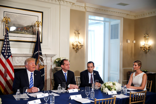 U.S. President Donald Trump (L) sits with (L-R) Labor Secretary Alex Acosta, Assistant to the President and Director of the Domestic Policy Council Andrew Bremberg and his daughter and Advisor to the President Ivanka Trump as he speaks to reporters during a workforce and economic discussion where he addressed questions about North Korea at his golf estate in Bedminster, New Jersey U.S. August 11, 2017. REUTERS/Jonathan Ernst - RTS1BEVQ