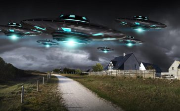 Metal and silver UFO invasion on planet earth landascape 3D rendering (Shutterstock/sdecoret)