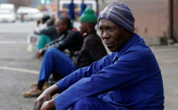 Unemployed men wait on a street corner in the hope of getting casual work in Pietermaritzburg, South Africa June 28, 2017. REUTERS/Rogan Ward - RTS18XSQ