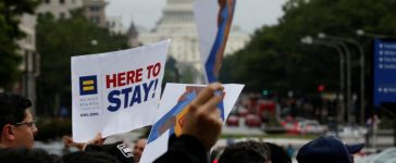 FILE PHOTO: Demonstrators carrying signs supporting immigrants march during a rally by immigration activists CASA and United We Dream demanding the Trump administration protect the Deferred Action for Childhood Arrivals (DACA) program and the Temporary Protection Status (TPS) programs, in Washington, U.S., August 15, 2017. REUTERS/Joshua Roberts