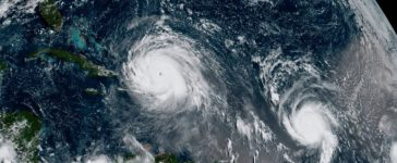 Hurricane Irma (L) and Hurricane Jose are pictured in the Atlantic Ocean in this NOAA satellite handout photo