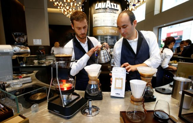 "A barman prepares Lavazza ""slow coffee"" blend during the new opening of Lavazza's flagship coffee store in Milan, Italy, September 19, 2017. REUTERS/Stefano Rellandini"