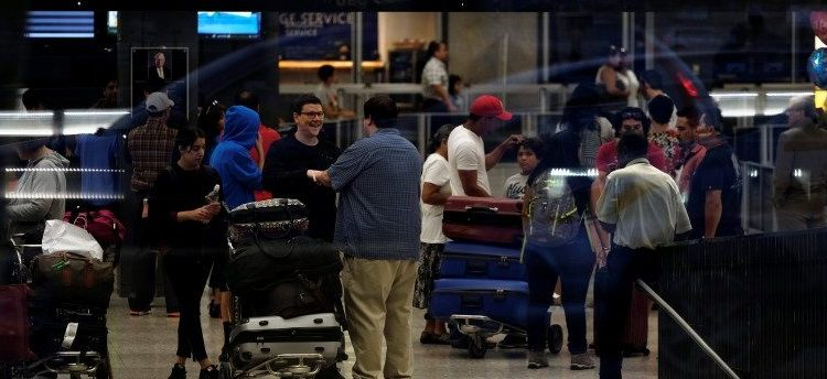 International passengers arrive at Washington Dulles International Airport after clearing immigration and customs in Dulles, Virginia, September 24, 2017. REUTERS/James Lawler Duggan