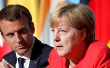 Macron and Merkel attend a news conference following talks on EU integration, defence and migration in Paris