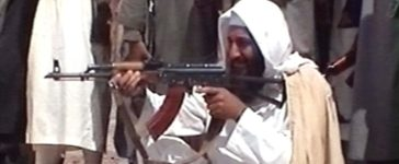 Saudi-born terrorist suspect Osama bin Laden is seen aiming a weapon in this undated photo from Al-Jazeera TV. (Photo by Al-Jazeera/Getty Images)