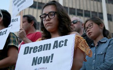 Alejandra Garcia (C) stands with supporters of the Deferred Action for Childhood Arrivals (DACA) program during a rally outside the Edward R. Roybal Federal Building in Los Angeles, California, U.S. September 5, 2017. REUTERS/Kyle Grillot