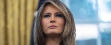 US First Lady Melania Trump looks on as President Donald Trump speaks after receiving an update from disaster relief organizations on Hurricane Harvey recovery efforts in the Oval Office at the White House in Washington, DC, on September 1, 2017. / AFP PHOTO / NICHOLAS KAMM (Photo credit should read NICHOLAS KAMM/AFP/Getty Images)