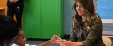 US First Lady Melania Trump (R) shares crayons with a student as she visits a youth centre at Joint Andrews Airforce base, Maryland on September 15, 2017. / AFP PHOTO / JIM WATSON (Photo credit should read JIM WATSON/AFP/Getty Images)
