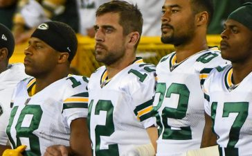 Green Bay Packers wide receiver Randall Cobb (18), quarterback Aaron Rodgers (12), tight end Richard Rodgers (82) and wide receiver Davante Adams (17) link arms during the National Anthem prior to their game against the Chicago Bears at Lambeau Field Sept. 28, 2017. (Photo: Benny Sieu-USA TODAY Sports)