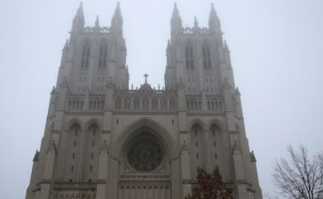 The National Cathedral is shrouded in fog before the National Prayer Service, which will be attended by U.S. President Donald Trump, in Washington, U.S., January 21, 2017. REUTERS/Joshua Roberts - RC1BFB242280