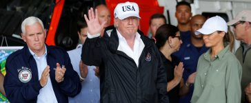 U.S. President Donald Trump waves after attending a briefing with Vice President Mike Pence (L) and first lady Melania Trump (R) on Hurricane Irma relief efforts in Fort Myers, Florida, U.S., September 14, 2017. REUTERS/Jonathan Ernst