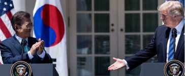 President Donald Trump reaches to shake the hand of South Korea's President Moon Jae-in. (BRENDAN SMIALOWSKI/AFP/Getty Images)