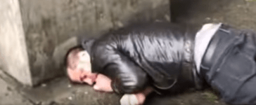 A man with a swastika armband is knocked unconscious in Seattle (Youtube).