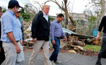 FILE PHOTO - President Trump walks past hurricane wreckage as he visits areas damaged by Hurricane Maria in Guaynabo, Puerto Rico