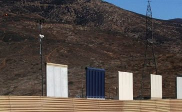 Prototypes for U.S. President Donald Trump's border wall with Mexico are shown near completion behind the current border fence, in this picture taken from the Mexican side of the border, in Tijuana, Mexico, October 23, 2017. REUTERS/Jorge Duenes