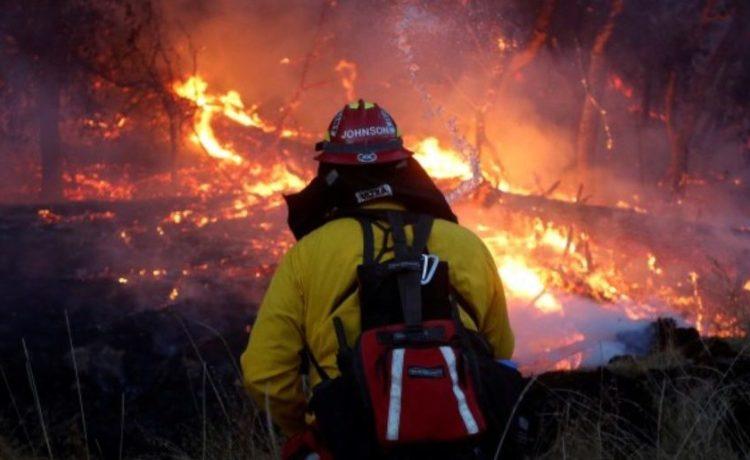 FILE PHOTO: Firefighters battle a wildfire near Santa Rosa, California