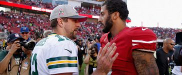 Colin Kaepernick #7 of the San Francisco 49ers talks with Aaron Rodgers #12 of the Green Bay Packers after their game at Levi's Stadium on October 4, 2015 in Santa Clara, California. (Photo by Ezra Shaw/Getty Images)