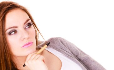 Confused student ponders her predicament (Shutterstock/Voyagerix)