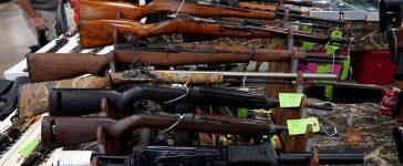 Rifles are displayed for sale at the Guntoberfest gun show in Oaks, Pennsylvania, U.S., October 6, 2017. REUTERS/Joshua Roberts
