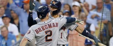LOS ANGELES, CA - OCTOBER 24: Alex Bregman #2 of the Houston Astros celebrates with Carlos Correa #1 after hitting a solo home run during the fourth inning against the Los Angeles Dodgers in game one of the 2017 World Series at Dodger Stadium on October 24, 2017 in Los Angeles, California. (Photo by Sean M. Haffey/Getty Images)