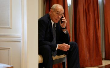 White House Chief of Staff John Kelly speaks on his phone in a hallway outside the room where U.S. President Donald Trump was meeting with Ukraine President Petro Poroshenko during the U.N. General Assembly in New York, U.S., September 21, 2017. REUTERS/Kevin Lamarque