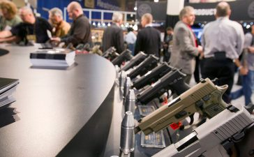 Sig Sauer handguns are displayed during the annual SHOT (Shooting, Hunting, Outdoor Trade) Show in Las Vegas January 15, 2013. Gun dealers at the show are reporting booming sales resulting from worries about possible gun control legislation. REUTERS/Las Vegas Sun/Steve Marcus