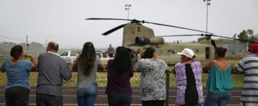 UTUADO, PUERTO RICO - OCTOBER 18: Local residents watch after a U.S. Army helicopter landed during food and water delivery efforts four weeks after Hurricane Maria struck on October 18, 2017 in Utuado, Puerto Rico. U.S. soldiers and agents delivered supplies provided by FEMA to remote residents in mountainous Utuado. Puerto Rico is suffering shortages of food and water in areas with only 19.10 percent of grid electricity restored. Puerto Rico experienced widespread damage including most of the electrical, gas and water grid as well as agriculture after Hurricane Maria, a category 4 hurricane, swept through. (Photo by Mario Tama/Getty Images)