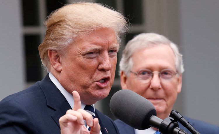 U.S. President Donald Trump speaks to the media with U.S. Senate Majority Leader Mitch McConnell at his side in the Rose Garden of the White House in Washington, U.S., October 16, 2017. REUTERS/Kevin Lamarque