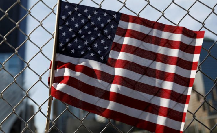 An American flag is seen left on a fence outside the National 9/11 Memorial and Museum during ceremonies marking the 16th anniversary of the September 11, 2001 attacks in New York, U.S., September 11, 2017. REUTERS/Shannon Stapleton