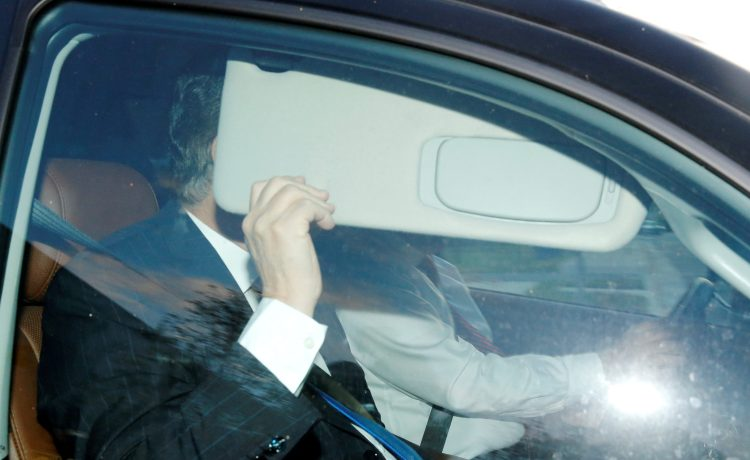 Former Trump campaign manager Paul Manafort, one focus of special counsel Robert Mueller's investigation into alleged Russian meddling in the 2016 U.S. presidential election, hides behind his car visor as he leaves his home in Alexandria, Virginia, U.S. October 30, 2017. REUTERS/Jonathan Ernst TPX IMAGES OF THE DAY - RC1D355C7C60