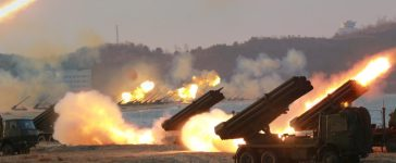 Multiple rocket launchers are seen being fired during a military drill at an unknown location, in this undated photo released by North Korea's Korean Central News Agency (KCNA) on March 25, 2016. REUTERS/KCNA