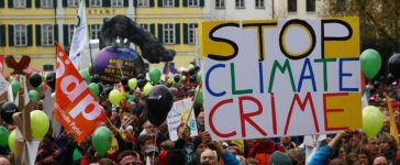 """People march during a demonstration under the banner """"Protect the climate - stop coal"""" two days before the start of the COP 23 UN Climate Change Conference hosted by Fiji but held in Bonn"""