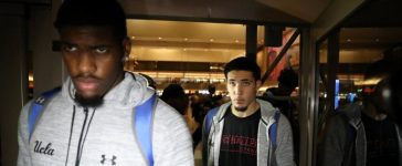 UCLA basketball players LiAngelo Ball (R) and Cody Riley arrive at LAX after flying back from China where they were detained on suspicion of shoplifting, in Los Angeles, California U.S. November 14, 2017. REUTERS/Lucy Nicholson