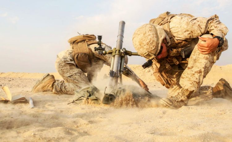 U.S. 5TH FLEET AREA OF OPERATIONS – Marines with A. Company, 1st Battalion 5th Marine Regiment the 15th Marine Expeditionary Unit's (MEU) Ground Combat Element, fire a M224 60mm lightweight mortar system during a live-fire mortar range, Oct. 18, 2017. The 15th MEU is embarked on the America ARG and is deployed to maintain regional security in the U.S. 5th Fleet area of operations. (U.S. Marine Corps photo by Cpl. Timothy Valero)