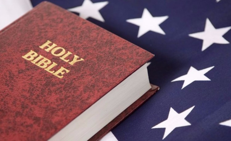 A Bible is on the USA flag. (Photo: Shutterstock/Mark Hayes)