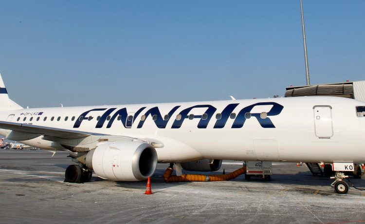 Finnair airplane is docked at the Chopin International Airport in Warsaw February 6, 2012. Finnair will present its Quarterly results on February 9, 2012. REUTERS/Peter Andrews