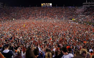 Auburn fans storm the field in celebration after the victory over the Alabama Crimson Tide at Jordan Hare Stadium on November 25, 2017 in Auburn, Alabama. (Photo by Kevin C. Cox/Getty Images)