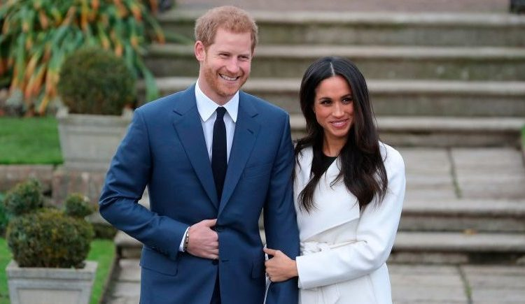 Britain's Prince Harry and his fiancée US actress Meghan Markle pose for a photographs in the Sunken Garden at Kensington Palace in London this morning following the announcement of their engagement. (Photo credit /DANIEL LEAL-OLIVAS/AFP/Getty Images)