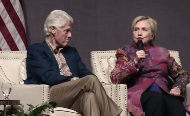 Hillary Clinton speaks alongside her husband former President Bill Clinton at a Clinton Foundation event commemorating the 25th anniversary of Bill Clintons election victory in 1992. [Screenshot/Facebook Live]
