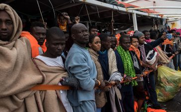 Refugees and migrants wait on deck of the Spanish NGO Proactiva Open Arms rescue vessel Golfo Azzurro to disembark after being rescued off Libyan coast north of Sabratha, Libya on February 19, 2017 in Pozzallo, Italy. 466 migrants were rescued in high seas last Friday by the Italian Coast Guard and the Spanish NGO Proactiva Open Arms rescue vessel Golfo Azzurro. Proactiva Open Arms are a Spanish charity based out of Malta who provide search and rescue assistance to refugees and migrants in distress at sea. They patrol the SAR and Rescue Zone off the coast of Libya running rescue missions for the hundreds of migrants who continue to make perilous journey across the Mediterranean in hope of reaching the European mainland. (Photo by David Ramos/Getty Images)